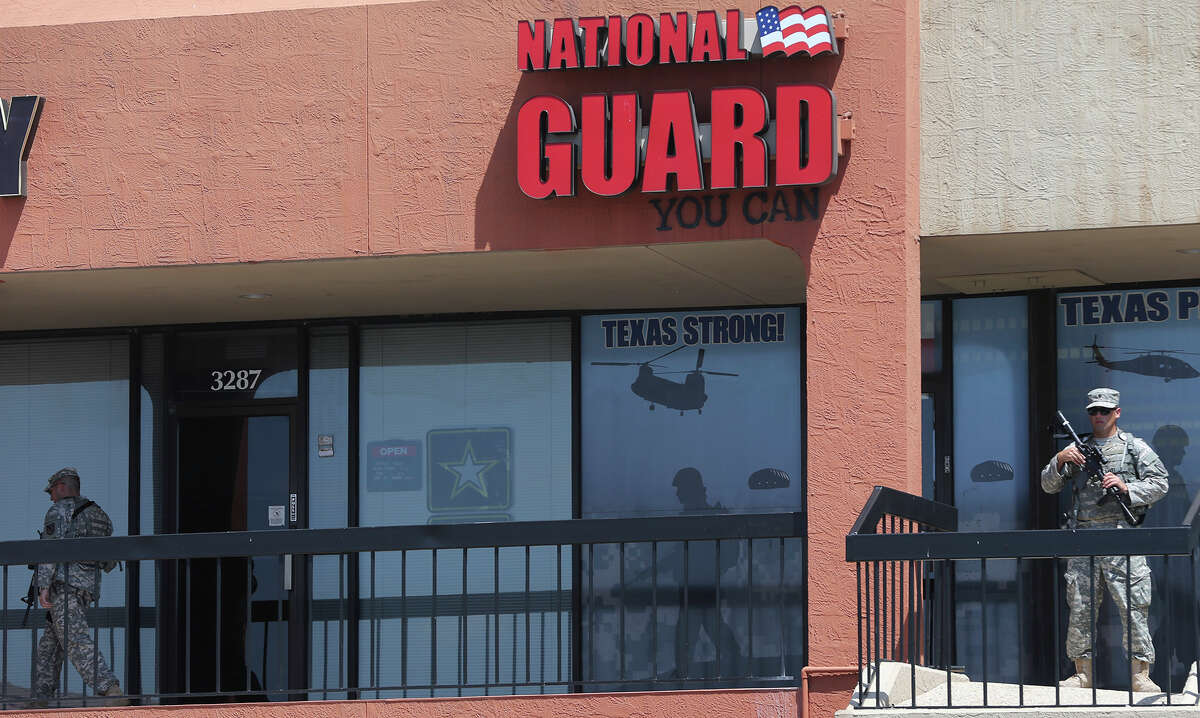 Armed Texas Army National Guardsmen are in front of recruiting office Thursday July 23, 2015 on the 3200 block of Wurzbach Road.