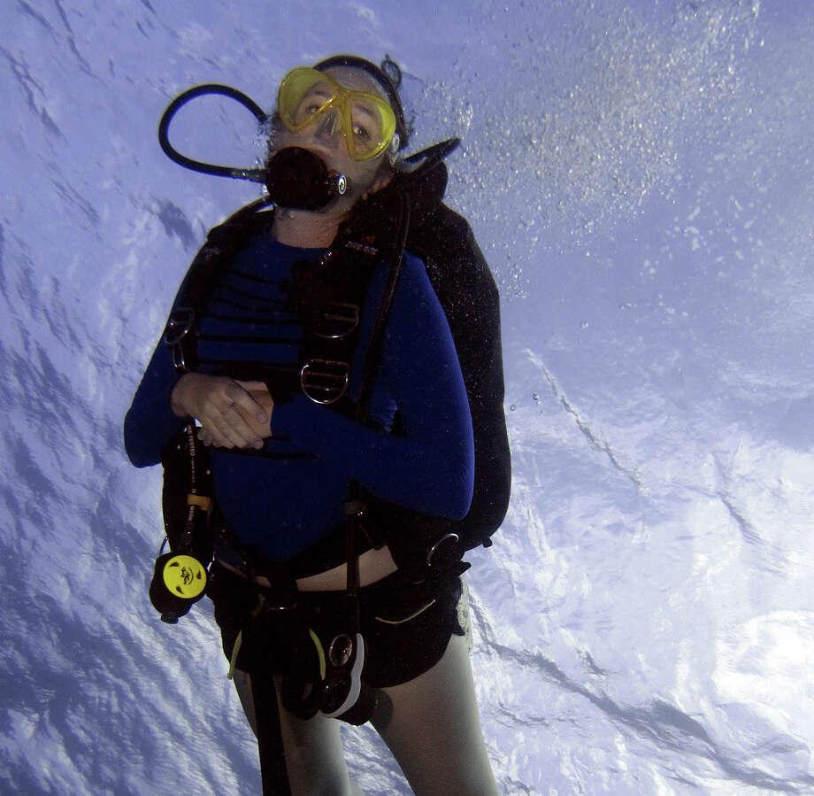 Scuba diver enjoys the crystal clear waters of the Exuma Islands near Nassau, Grand Bahamas. Photo: Courtesy Photo