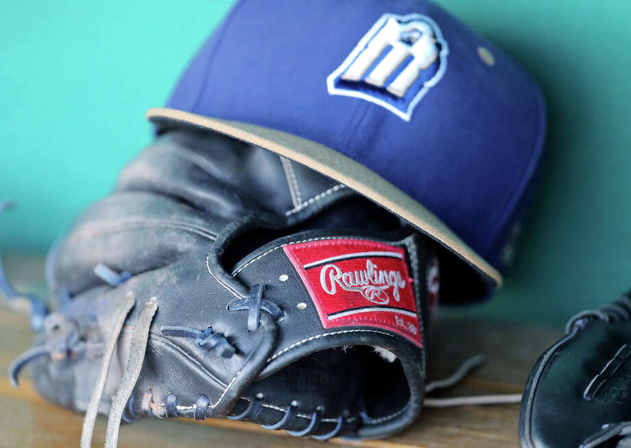 Detail of a glove and baseball cap in the Missions' dugout during the game with the Tulsa Drillers on July 11, 2015 at Wolff Stadium. Photo: Edward A. Ornelas /San Antonio Express-News / © 2015 San Antonio Express-News