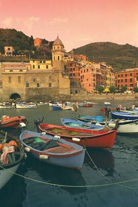 Sunrise heightens the charm of Italy's seaside villages — such as Vernazza in the Cinque Terre.