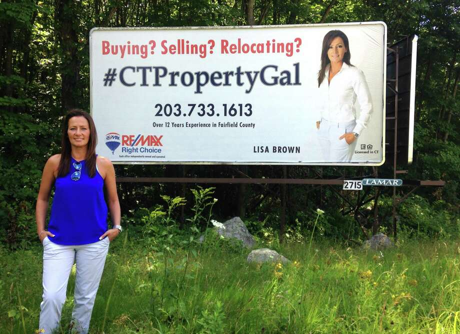 Lisa Brown, a Danbury area real estate agent who specializes in residential properties, recently paid for a billboard to market her hashtag, #CTpropertygal, combining both traditional and digital marketing methods. The billboard can be seen when driving southbound on Pembrook Road in Danbury, Conn. Photo: Dirk Perrefort / Hearst Connecticut Media / The News-Times
