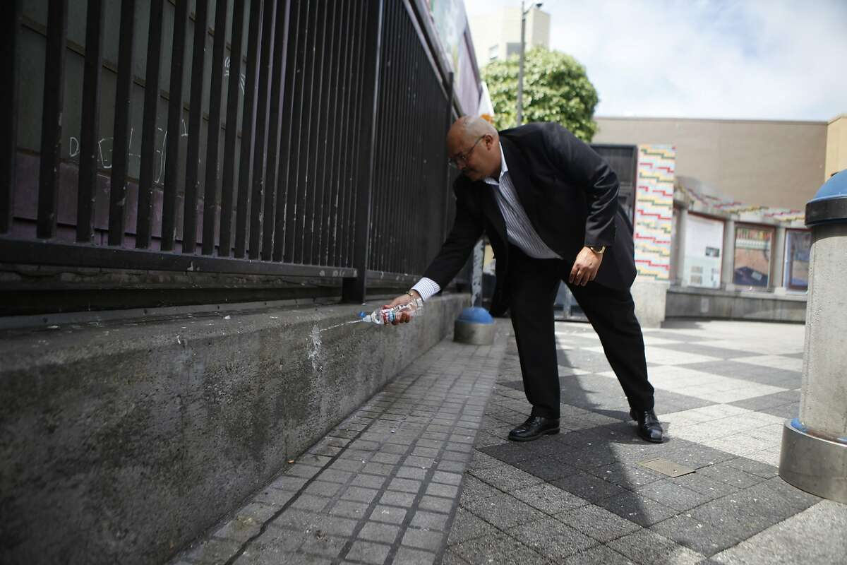 Using the wall at 16th Street and Mission as an example, Public Works director Mohammed Nuru demonstrates how the walls deflect liquid onto the clothes of those that urinate on the walls.
