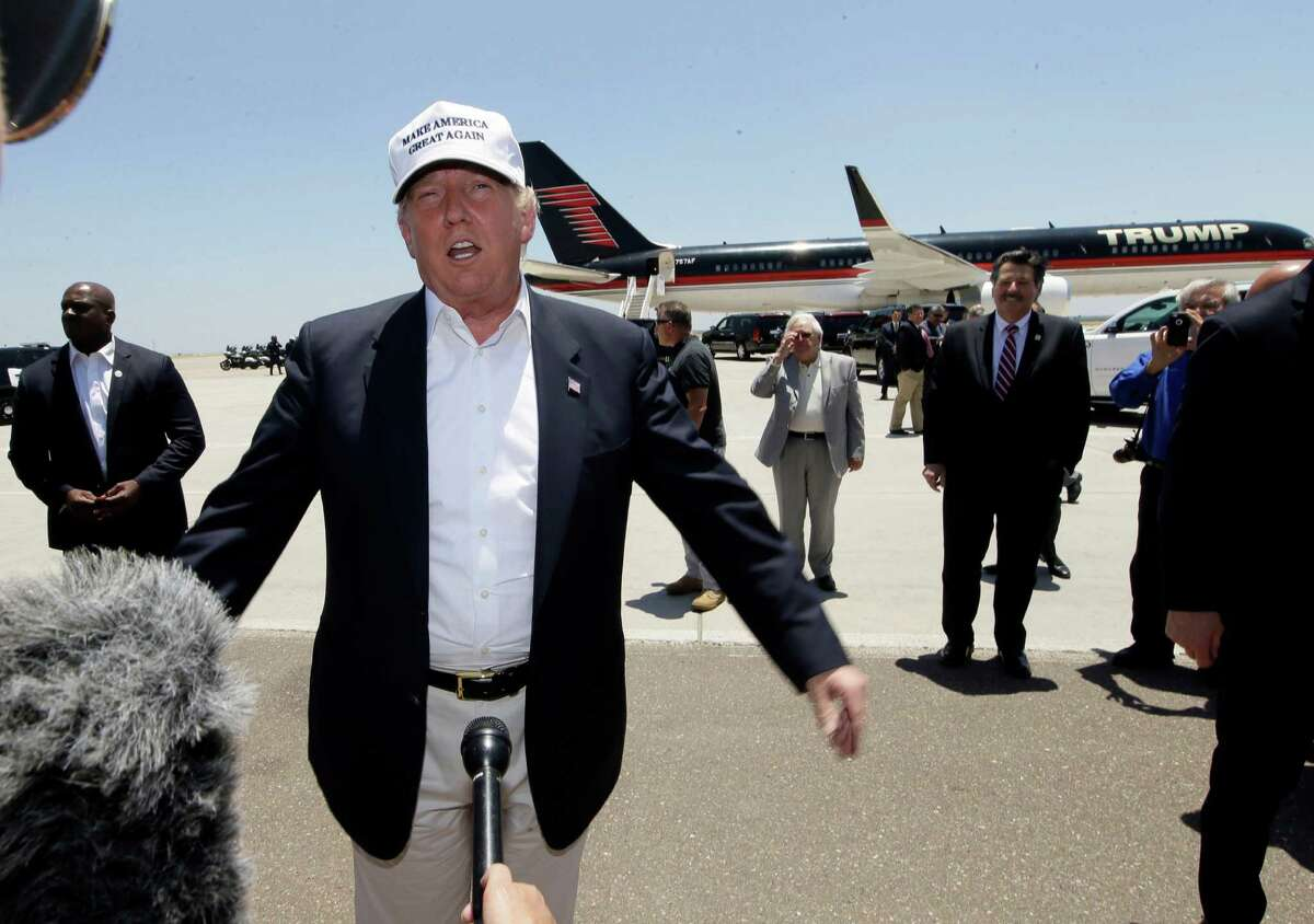Republican presidential hopeful Donald Trump speaks after arriving at the airport for a visit to the U.S. Mexico border in Laredo, Texas, Thursday, July 23, 2015. (AP Photo/LM Otero)