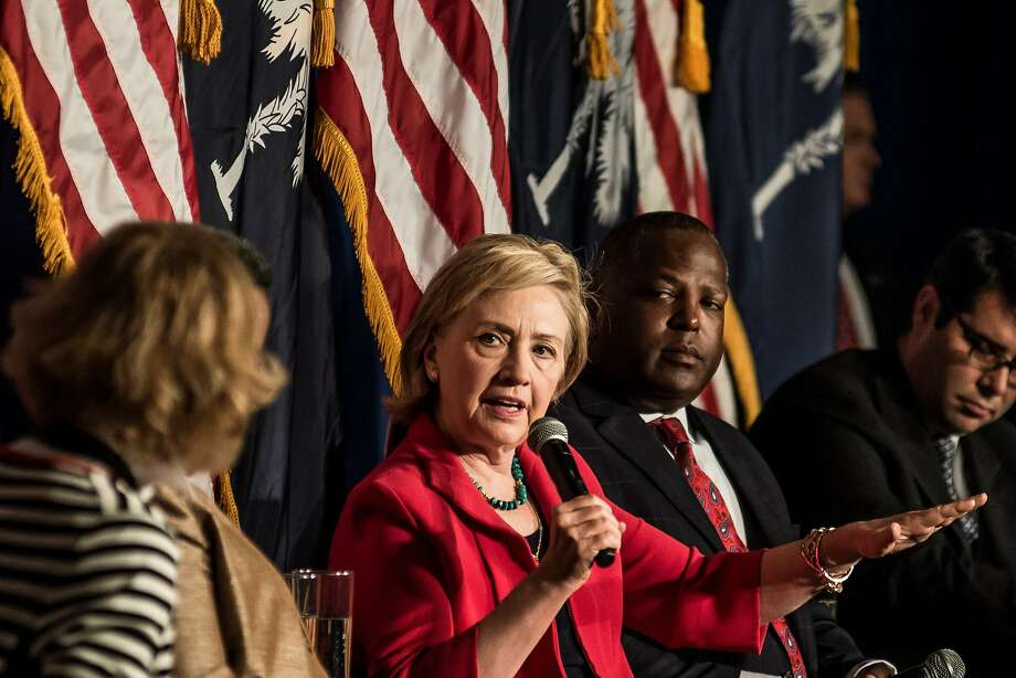 Hillary Rodham Clinton rails against Wall Street, but has brought in big money from financial giants. Photo: Sean Rayford, Getty Images