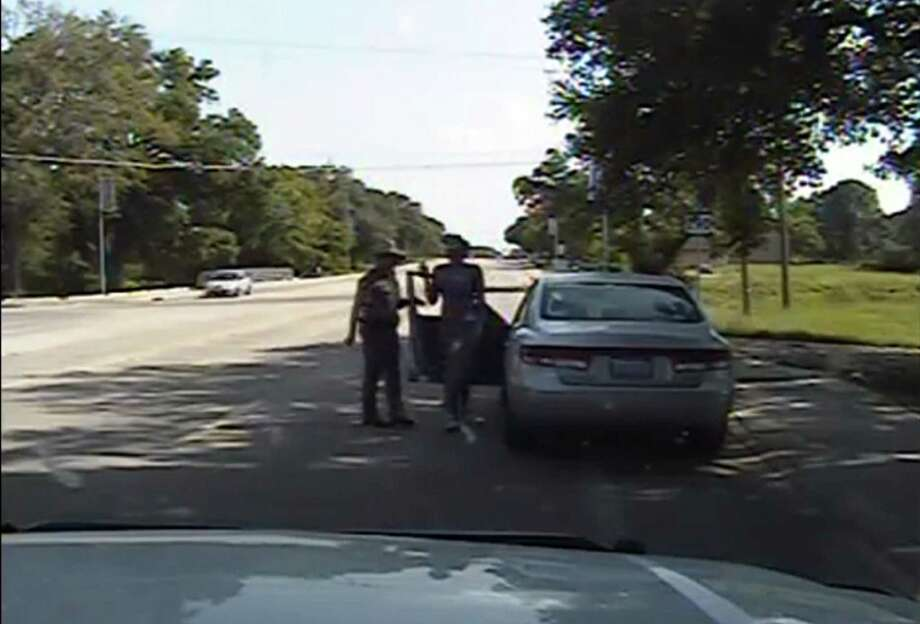 This screen grab taken from video footage from the arresting officer's dashcam, released by the Texas Department of Public Safety on Wednesday shows Texas state trooper Brian Encinia next to the car as 28-year-old Sandra Bland gets out of her vehicle following a stop for allegedly failing to signal a lane change, in Waller County, Texas on July 10. Photo: TEXAS DEP. OF PUBLIC SAFETY /AFP / Getty Images / AFP