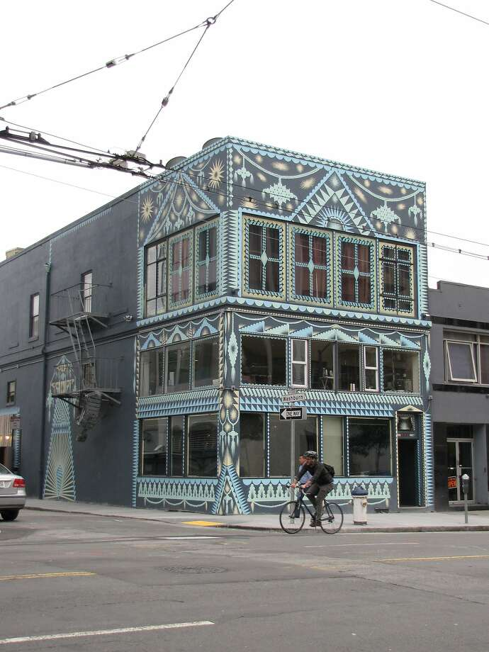 This three-story building at Mission and Washburn streets now houses the bar Oddjob, which hired the Los Angeles artist Shrine to give it a distinctive new look in May. Nearby are at least five new large residential buildings either under construction or recently completed. Photo: John King, The Chronicle