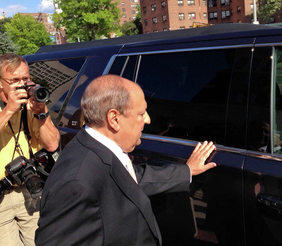New York State Sen. Thomas Libous, R-Binghamton, leaves federal court in White Plains, N.Y., Wednesday, July 22, 2015.  The New York State Senate's deputy majority leader, Libous was found guilty of lying to the FBI about arranging a high-paying job for his son. Under state law, the felony conviction means Thomas Libous loses his seat. (AP Photo/Jim Fitzgerald) ORG XMIT: NYR106 Photo: Jim Fitzgerald / AP