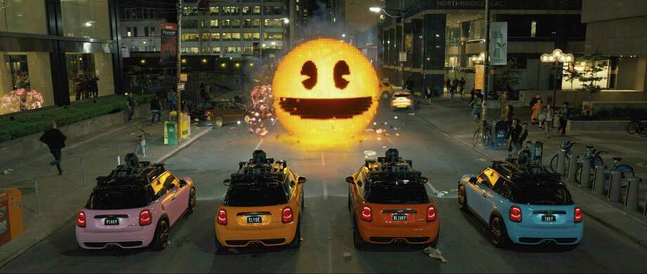 "This photo provided by courtesy of Sony Pictures shows, Inky, Blinky, Clyde and Pinky in Columbia Pictures' ""Pixels."" The movie opens in U.S. theaters on July 24, 2015.  (Sony Pictures via AP) ORG XMIT: CAET397 Photo: Courtesy Of Sony Pictures / Sony Pictures"