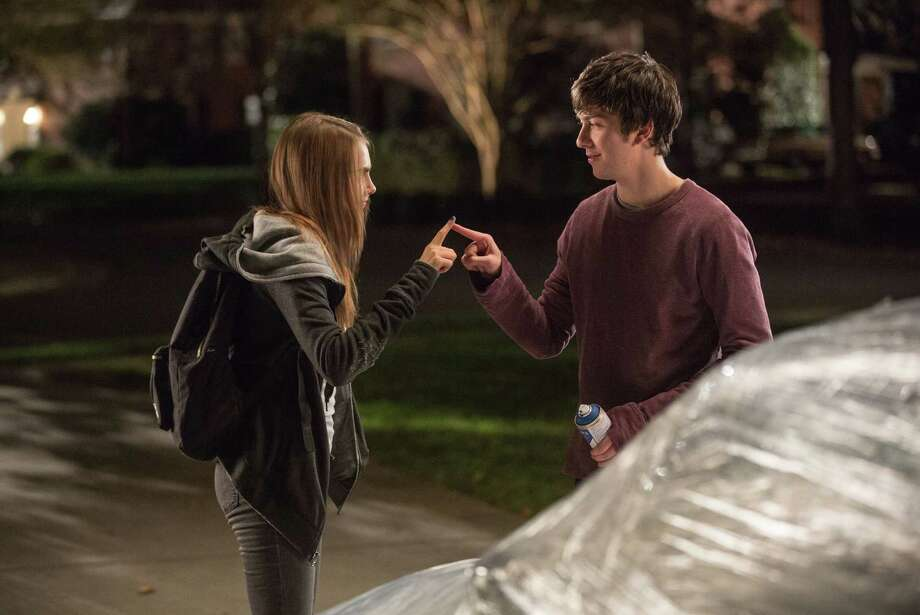 """This photo provided by Twentieth Century Fox shows longtime neighbors, Cara Delevingne, left, as Margo, and Nat Wolff as Quentin in a scene from the film, """"Paper Towns.""""  (Michael Tackett/Twentieth Century Fox via AP) ORG XMIT: CAET420 Photo: Michael Tackett / Twentieth Century Fox"""