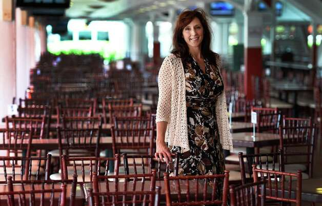 Lynn LaRocca, Chief Experience Officer stands in the first floor dining area of the clubhouse this morning July 22, 2015, on the main track at the Saratoga Race Course in Saratoga Springs, N.Y.        (Skip Dickstein/Times Union) Photo: SKIP DICKSTEIN / 00032711A
