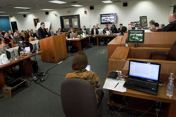 Fifteen lawyers representing six different plaintiff groups crowded one side of the Travis County courtroom of state District Judge John Dietz on Monday, Oct. 22, 2012 in Austin, Texas. to launch the sweeping school finance trial involving about two-thirds of Texas school districts. Judge Dietz listens to the opening remarks from attorney David Hinojosa, representing the Mexican American Legal Defense and Educational Fund. (AP Photo/Austin American-Statesman, Ralph Barrera)