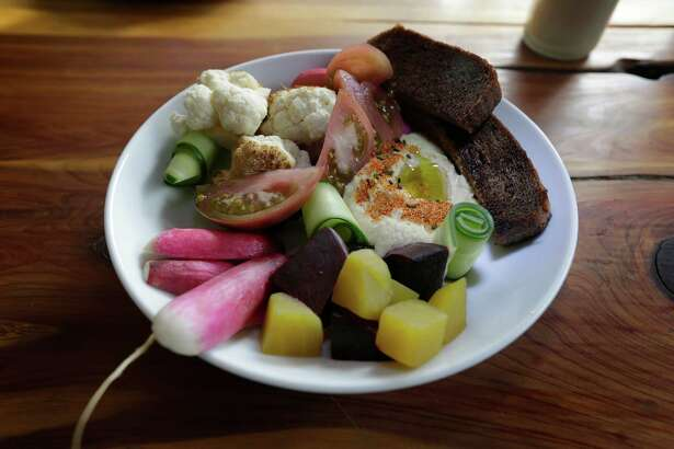 Fresh and lightly pickled vegetables, served with hummus and artisan pumpernickel bread make the crudités at Alchemy Kombucha and culture.
