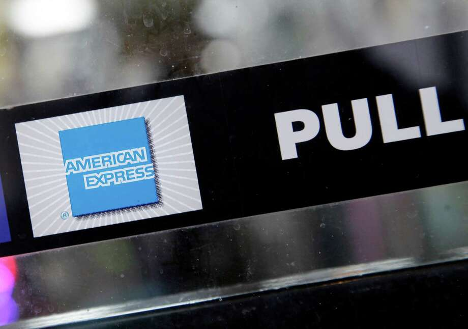 FILE - This Jan. 21, 2015 file photo ,shows the American Express logo displayed in the window of a New York business. American Express reports quarterly financial results on Wednesday, July 22, 2015. (AP Photo/Mark Lennihan, File) ORG XMIT: NYBZ179 Photo: Mark Lennihan / AP