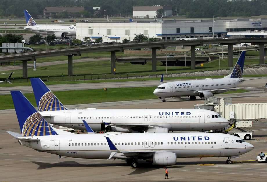 FILE - In this July 8, 2015, file photo, a United Airlines plane, front, is pushed back from a gate at George Bush Intercontinental Airport in Houston. United Airlines reports quarterly financial results on Thursday, July 23, 2015. (AP Photo/David J. Phillip, File) ORG XMIT: NYBZ195 Photo: David J. Phillip / AP