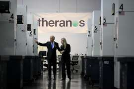 Vice President Joe Biden takes a tour of a Theranos production facility with Elizabeth Holmes, CEO of Theranos, in Newark, California, on Thursday, July 23, 2015.