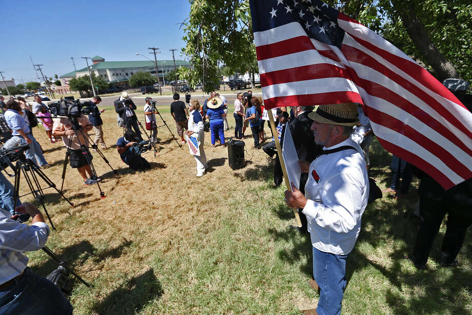 Protestors gather outside a private hanger while waiting for the arrival of Republican primary presidential candidate Donald Trump in Laredo, Thursday, July 23, 2015. At an event center, Trump talked to a group of law enforcement personnel drawing loud cheers of support from the crowd. Photo: JERRY LARA, Staff / San Antonio Express-News / © 2015 San Antonio Express-News