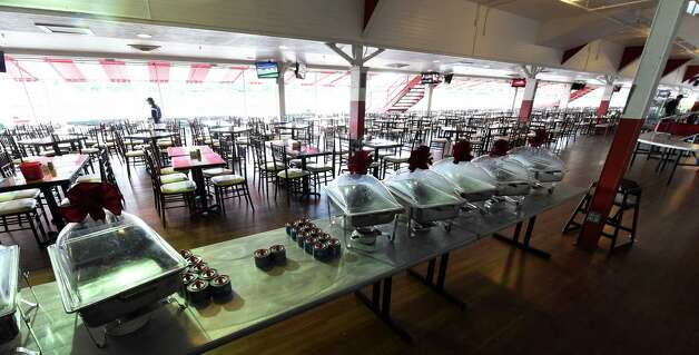 The first floor dining room is all ready for the crowds Thursday, July 23, 2015, at the Saratoga Race Course in Saratoga Springs, N.Y. The historic track opens Friday.  (Skip Dickstein/Times Union) Photo: SKIP DICKSTEIN / 00032589A
