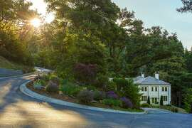 The six-bedroom Woodside estate sits on nearly 24 acres with ocean views and a private forest.