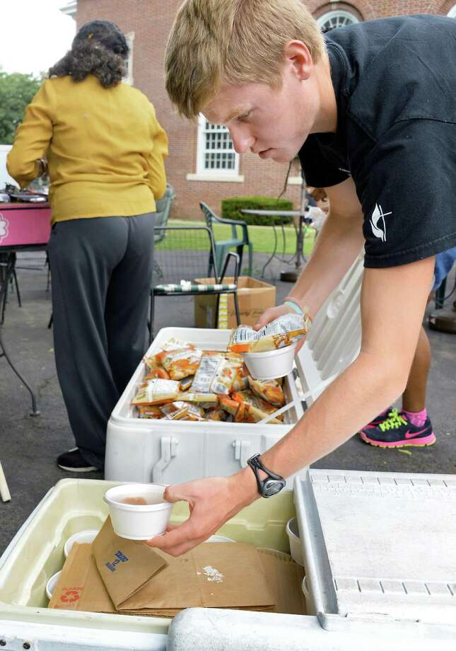 Capital Area Council of Churches volunteer Kyle Gronostaj packs food for their Mobile lunch program at First Lutheran Church Thursday July 23, 2015 in Albany, NY.  (John Carl D'Annibale / Times Union) Photo: John Carl D'Annibale / 00032723A
