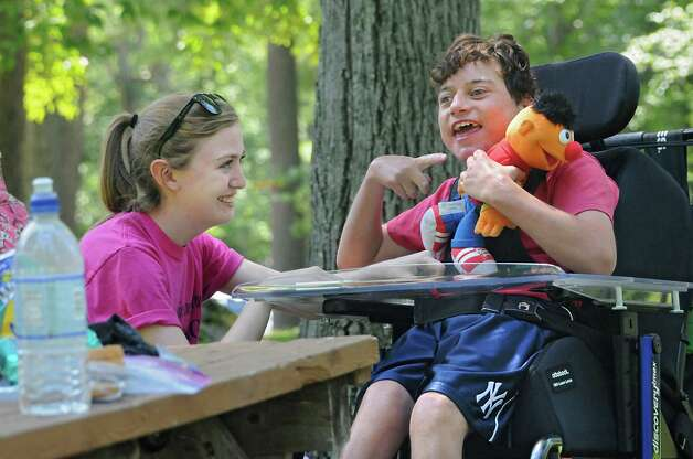 Camp counselor Deirdre Stevens of Guilderland, left, interacts with Nick Watrobski, 20, of Clifton Park at Camp Colonie which is run by Easter Seals at Colonie Mohawk River Park on Thursday, July 23, 2015 in Cohoes, N.Y.  (Lori Van Buren / Times Union) Photo: Lori Van Buren / 00032701A
