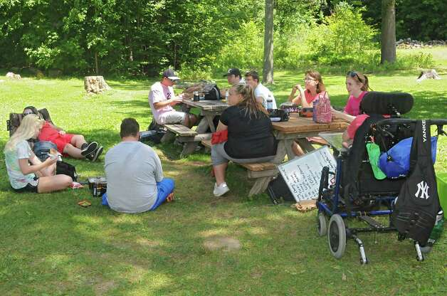 Kids and counselors have lunch after swimming at Camp Colonie which is run by Easter Seals at Colonie Mohawk River Park on Thursday, July 23, 2015 in Cohoes, N.Y.  (Lori Van Buren / Times Union) Photo: Lori Van Buren / 00032701A