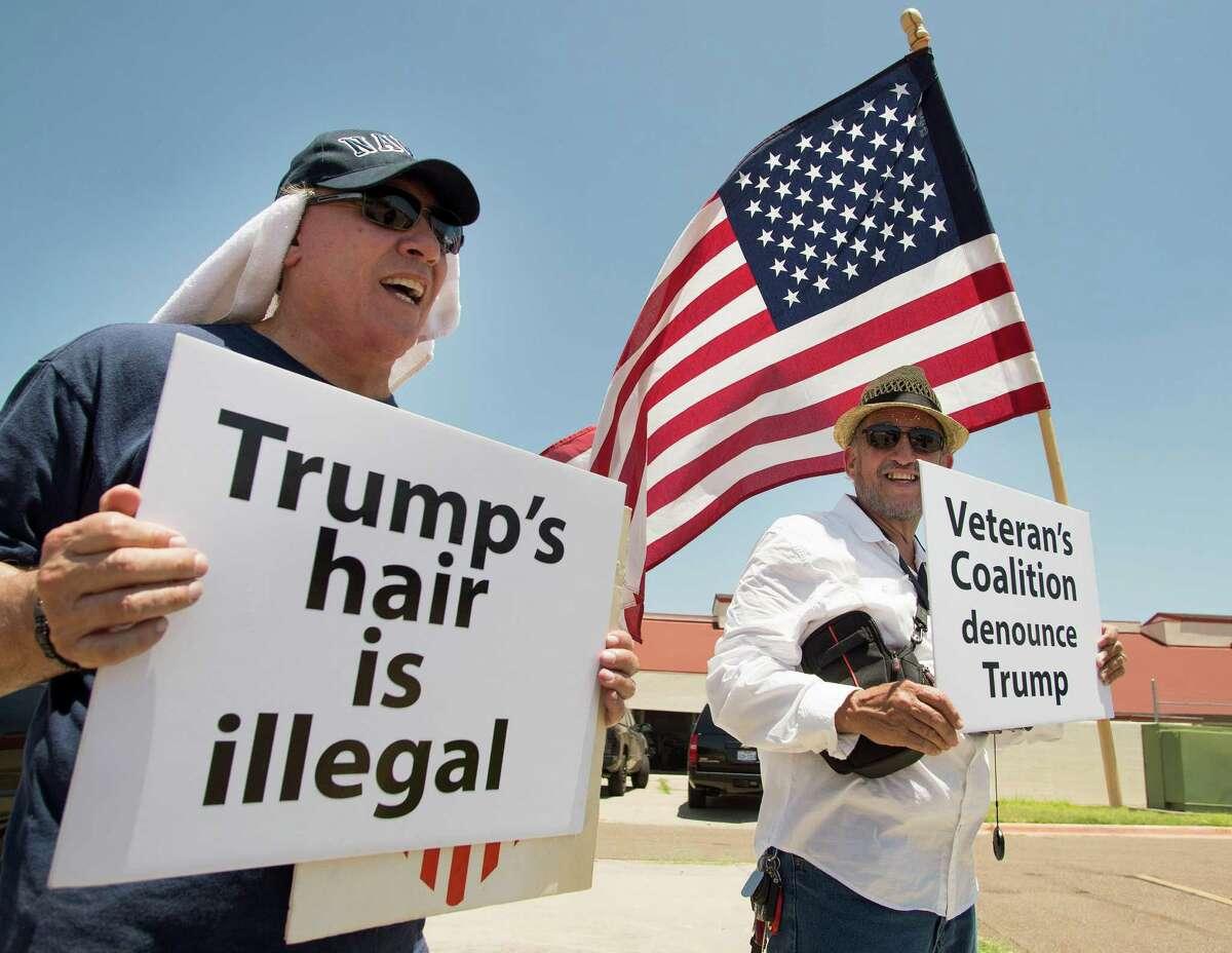 Veterans Rolando Gonzalez, left, and Adolfo Gonzalez were among those protesting Donald Trump's remarks about veterans on Thursday at Laredo International Airport.