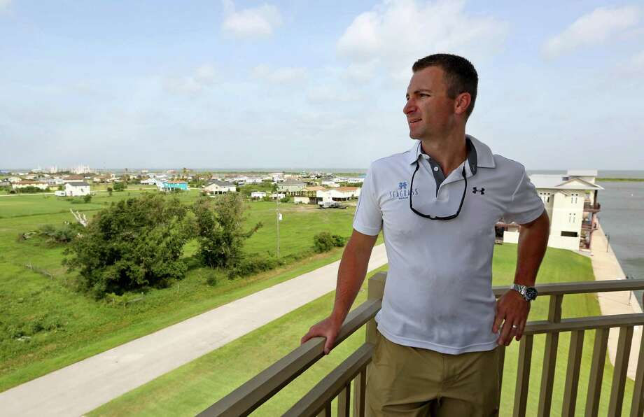 Developer Brad Ballard of New Coast Properties enjoys the view at a luxury house in Laguna Harbor, a newly planned community development. Photo: Gary Coronado /Houston Chronicle / © 2015 Houston Chronicle