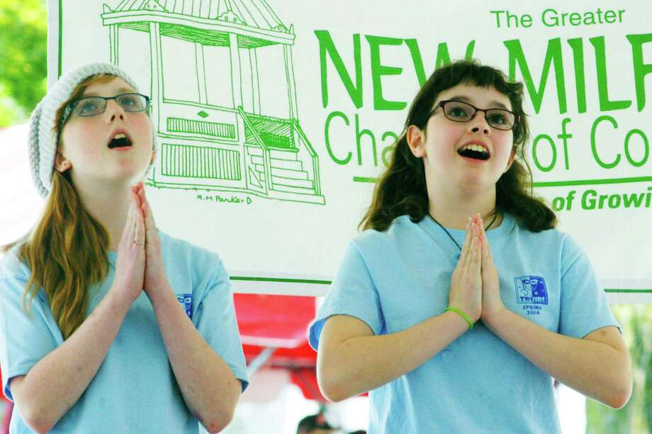 "Audrey Grello, left, Eva Clemence and fellow youths from TheatreWorks New Milford's summertime program perform a medley of songs last summer from ""The Sound of Music"" during the Greater New Milford Chamber of Commerce's 47th annual Village Fair Days on the Village Green. The 2015 Village Fair Days wlil be staged Friday and Saturday, July 24-25 in downtown New Milford. Photo: Norm Cummings / The News-Times"