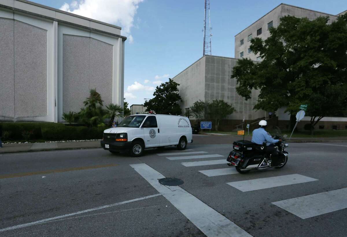 The Harris County Medical Examiner's van leaves the Houston Police Department Central Station after the suicide of a 38-year old asian male Thursday, July 23, 2015, in Houston.