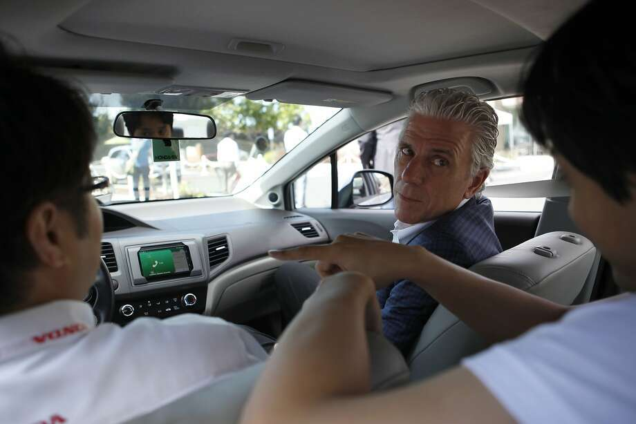 Rick Schostek , Executive Vice President of Honda North America, experiences the demo of Drivemode, an application that is more driver friendly, at Honda's new research and development facility in Mountain View, California, on Thursday, July 23, 2015. Photo: Brandon Chew, The Chronicle