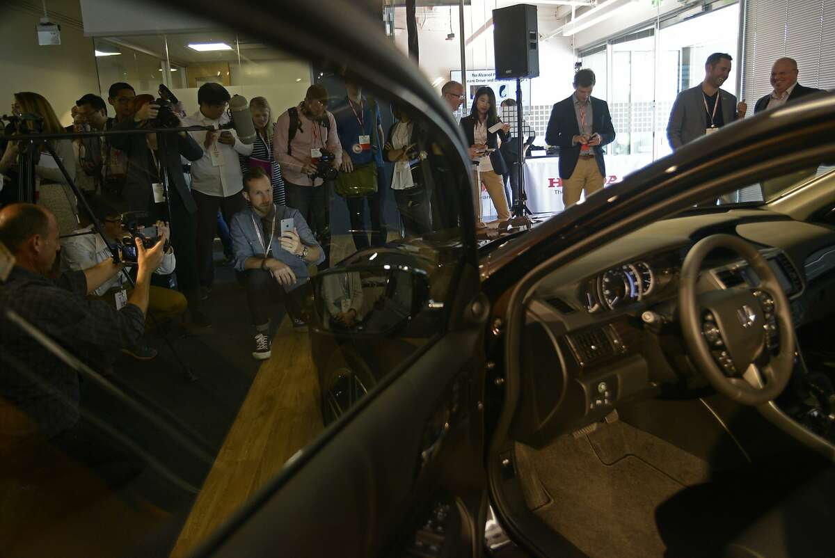 People gather around the unveiling of Honda's new 2016 Accord at their new research and development facility in Mountain View, California, on Thursday, July 23, 2015.