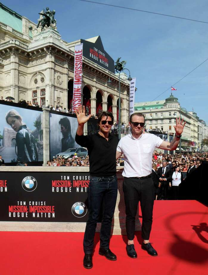 British actor Simon Pegg, right, and US actor Tom Cruise, pose for the media as they arrive for the Mission Impossible – Rogue Nation World Premiere, at the Vienna State Opera in Vienna, Austria, Thursday, July 23, 2015. (AP Photo/Ronald Zak) ORG XMIT: XRZ108 Photo: Ronald Zak / AP