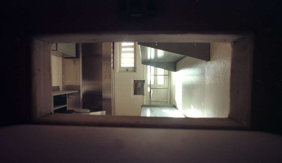 A narrow slot in the jailhouse cell door shows the interior of a solitary confinement jail cell under construction at the Five Points Correctional Facility, March 10, 2000, in Romulus, N.Y. (Steve Jacobs/Times Union) Photo: STEVE JACOBS / ALBANY TIMES UNION