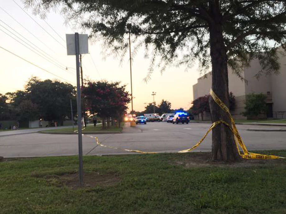 Police tape surrounds the scene following a shooting at a movie theater Thursday, July 23, 2015, in Lafayette, La. (Treylan Arceneaux via AP) ORG XMIT: NY128 Photo: Treylan Arceneaux / Treylan Arceneaux