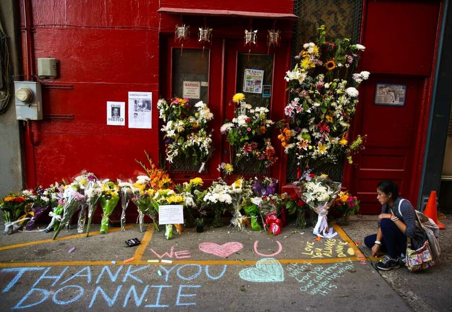 Doan Nguyen leaves a message for the late Donnie Chin outside his family business in the International District. Chin, a prominent local leader, was shot and killed early Thursday morning. Photo: JOSHUA TRIJULLO, SEATTLEPI.COM