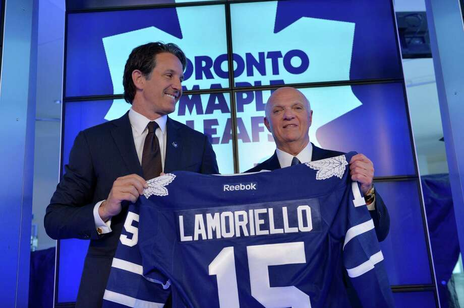 Toronto Maple Leafs President Brendan Shanahan, left,  and Lou Lamoriello hold up a jersey at a news conference to announce Lamoriello has been named the new general manager of the Maple Leafs NHL hockey team in Toronto, Thursday, July 23, 2015. (Galit Rodan/The Canadian Press via AP) ORG XMIT: GYR105 Photo: Galit Rodan / CP