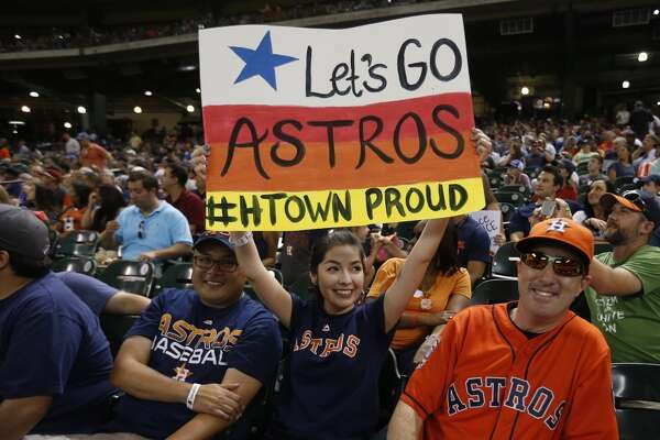 "Samantha Perez holds her ""Let's go Astros"" sign in the stands during the fifth inning of an MLB game at Minute Maid Park on Thursday, July 23, 2015, in Houston. ( Karen Warren / Houston Chronicle )"