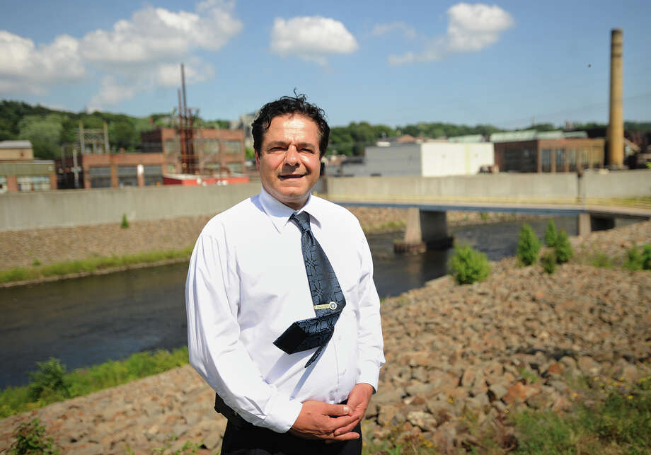 Ansonia Mayor David Cassetti stands across the Naugatuck River from the former Ansonia Copper & Brass property in Ansonia. Photo: Brian A. Pounds / Brian A. Pounds / Connecticut Post