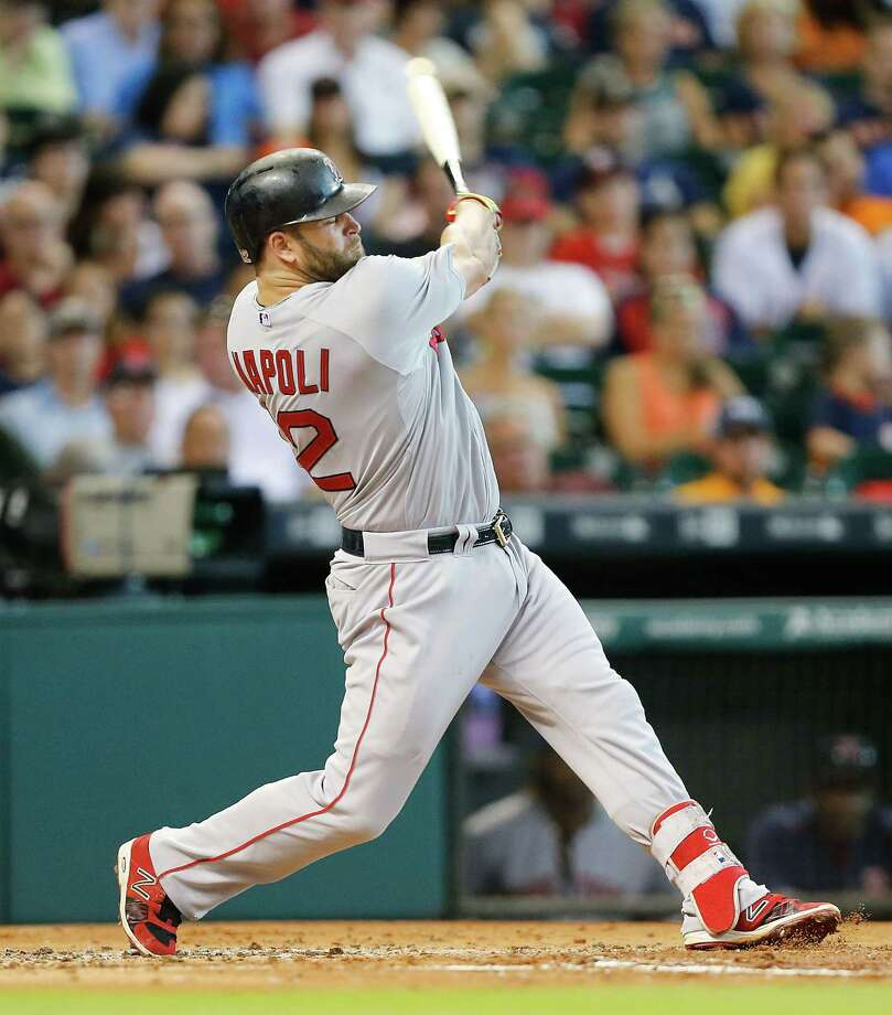HOUSTON, TX - JULY 23:  Mike Napoli #12 of the Boston Red Sox hits a home run in the second inning against the Houston Astros at Minute Maid Park on July 23, 2015 in Houston, Texas.  (Photo by Bob Levey/Getty Images) ORG XMIT: 538587209 Photo: Bob Levey / 2015 Getty Images