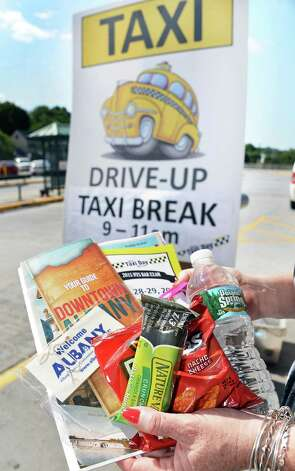 Albany Convention and Visitors Bureau's gift bag for cab drivers  at the Rensselaer train station as part of the bureau's sixth annual Taxi Day Thursday July 23, 2015 in Rensselaer, NY.  (John Carl D'Annibale / Times Union) Photo: John Carl D'Annibale / 00032726A