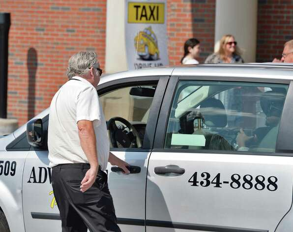 A cab picks up fares at the Rensselaer train station during the Albany Convention and Visitors Bureau's sixth annual Taxi Day Thursday July 23, 2015 in Rensselaer, NY.  (John Carl D'Annibale / Times Union) Photo: John Carl D'Annibale / 00032726A