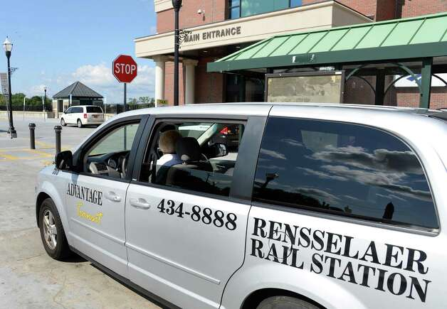 A cab pulls up to the Rensselaer train station during the Albany Convention and Visitors Bureau's sixth annual Taxi Day Thursday July 23, 2015 in Rensselaer, NY.  (John Carl D'Annibale / Times Union) Photo: John Carl D'Annibale / 00032726A
