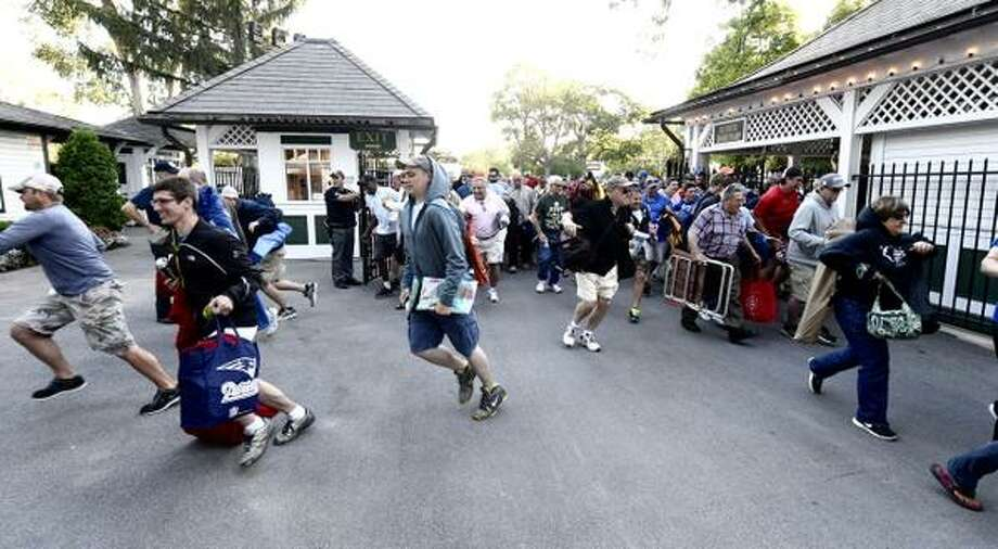 The early birds grab their tables at Saratoga Race Course Friday morning. ITS OPENING DAY!!!!! (Skip Dickstein / Times Union)