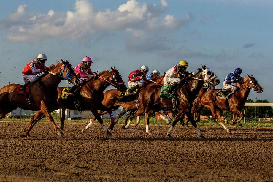The third race of the night at Retama Park in Selma, Texas on July 17, 2015 was a 550-yard $5000 Maiden Claiming race for horses 3 years and older with a purse of $3,300. Photo: Photos By Ray Whitehouse / San Antonio Express-News / 2015 San Antonio Express-News