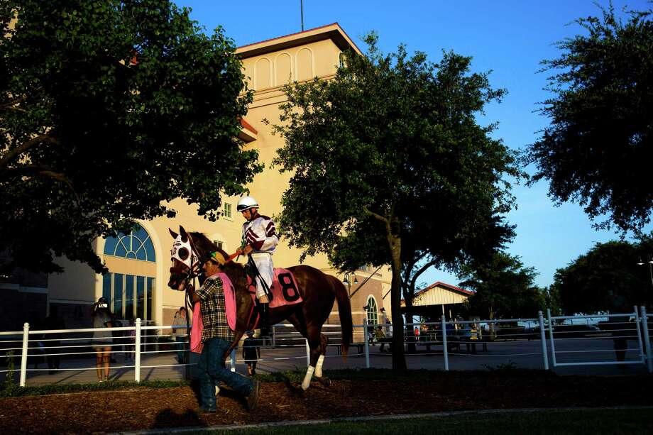 Donald Guynes rides Tnb Rockin Chick at Retama Park in Selma on July 17, 2015. Photo: Ray Whitehouse /San Antonio Express-News / 2015 San Antonio Express-News