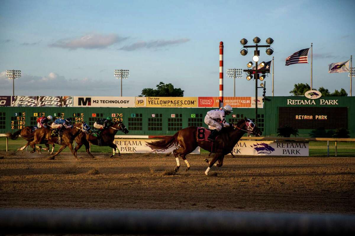 Tnb Rockin Chick, riden by Donald Guynes, wins the fourth race at Retama Park in Selma on July 17, 2015.