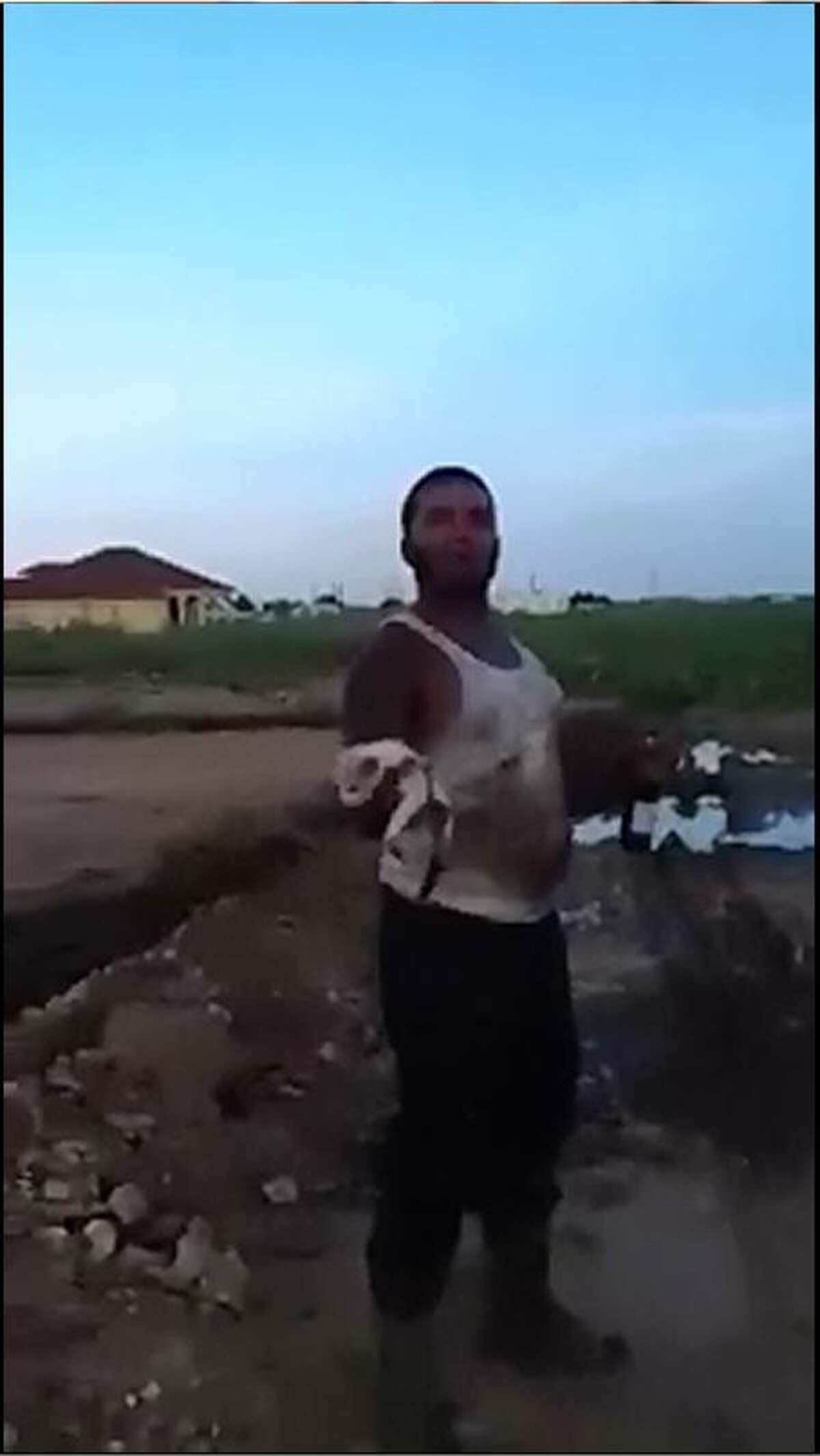 Screengrabs from a video posted online show an Odessa man flinging a small kitten across a field.