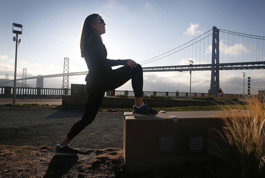 Michelle Skeen stretches before a final training run for the SF Marathon in San Francisco, Calif. on Friday, July 24, 2015. Skeen is entered in the double marathon where entrants will run the 26.2 mile course in reverse beginning at midnight Sunday and follow that up by running in the regular race later that morning, just a few hours after finishing the first leg. Photo: Paul Chinn, The Chronicle