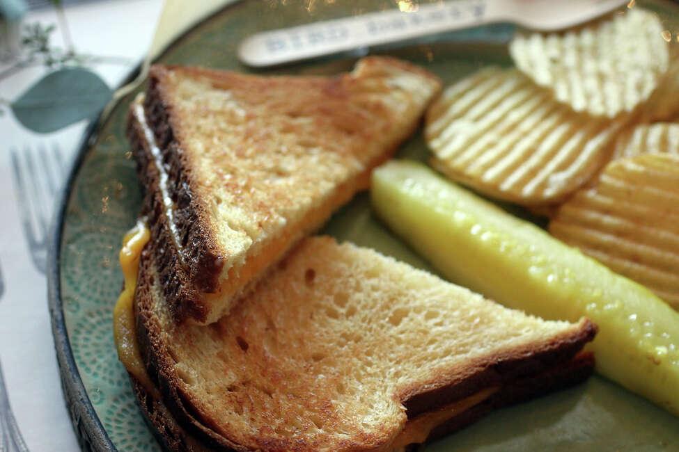 Nostalgic Grilled Cheese sandwich at Bird Bakery includes cheddar on brioche.