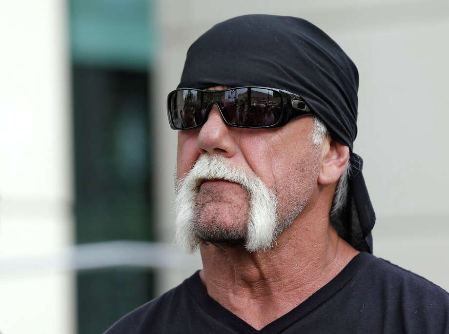 FILE - In this Oct. 15, 2012, file photo, reality TV star and former pro wrestler Hulk Hogan, whose real name is Terry Bollea, looks on as his attorney speaks during a news at the United States Courthouse in Tampa, Fla. Hogan is suing Gawker for invasion of privacy, after the New York-based website published a tape of Hogan having sex with his then-best friend's wife. The trial starts Monday, July 6, 2015. (AP Photo/Chris O'Meara, File) Photo: Chris O'Meara / AP